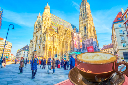 VIENNA, AUSTRIA - FEBRUARY 18, 2019: Enjoy the cup of hot Viennese Melange in cafe Aida with great view on Stephansdom, on February 18 in Vienna.