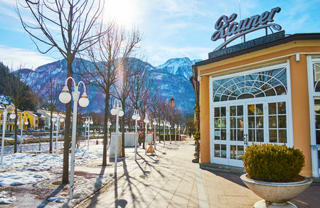 BAD ISCHL, AUSTRIA - FEBRUARY 26, 2019: Snowy Esplanade park, located on the bank of Traun river, is nice place for the day walk, on February 26 in Bad Ischl.