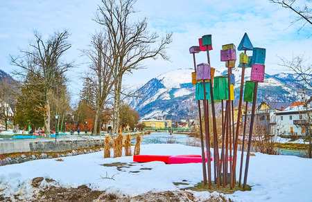 BAD ISCHL, AUSTRIA - FEBRUARY 26, 2019: Snowy Sissi Park is decorated with installation of many colored wooden birdhouses on sticks, on February 26 in Bad Ischl.
