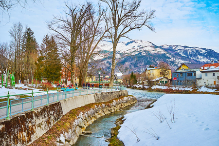 BAD ISCHL, AUSTRIA - FEBRUARY 26, 2019: Winter Sissi Park is nice place for the day walk, observing Traun river and snowy mountains,  on February 26 in Bad Ischl.