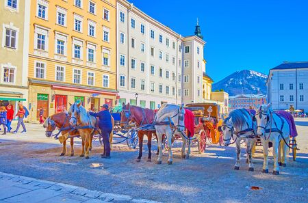 SALZBURG, AUSTRIA - FEBRUARY 27, 2019: Salzburg offers an unforgettable ride in a horse drawn carriage along the old town, on February 27 in Salzburg Éditoriale