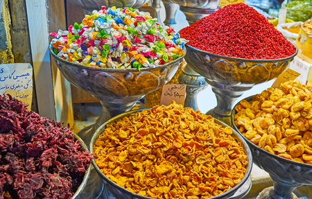 TEHRAN, IRAN - OCTOBER 25, 2017: Visit spices and sweets store in Tajrish Bazaar and choose local candies, candied hibiscus flowers, dried fruits, barberries, nuts or spices, on October 25 in Tehran Editorial