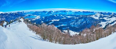Panorama from Zwolferhorn mountain top with a view on Alpine scenery, pine forests, peak of Spielbergalm and Wolfgangsee lake on the background, St Gilden, Salzkammegut, Austria
