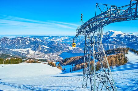 Enjoy Alpine landscape, clear surface of Wolfgangsee lake and vintage cableway from the  Zwolferhorn mountain peak, St Gilden, Salzkammergut, Austria