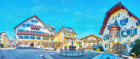 ST GILGEN, AUSTRIA - FEBRUARY 23, 2019: Panorama of historical Mozartplatz square with small fountain in the middle and old mansions, decorated with wooden and painted details, on February 23 in St Gilgen Redakční