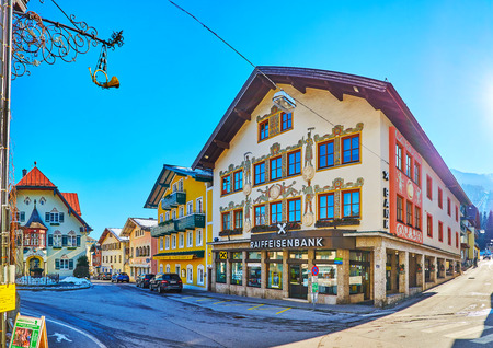 ST GILGEN, AUSTRIA - FEBRUARY 23, 2019: The line of old scenic edifices in Mozartplatz square with a town hall building on the background, on February 23 in St Gilgen
