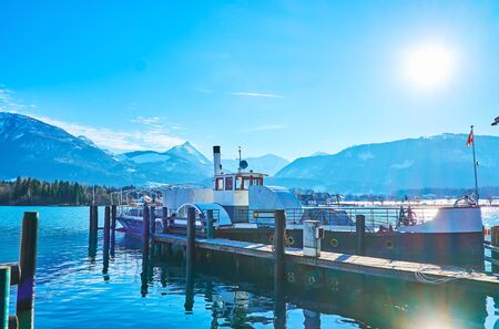 The vintage ferry is docked at the shipyard on Wolfgangsee lake, St Wolfgang, Salzkammergut, Austria 写真素材 - 130150251