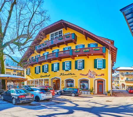ST GILGEN, AUSTRIA - FEBRUARY 23, 2019: The colorful edifice of historical hotel Gasthof Kendler, located in Kirchenplatz square of old town, on February 23 in St Gilgen