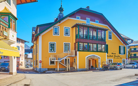 ST GILGEN, AUSTRIA - FEBRUARY 23, 2019: Exterior of historical edifice of the hotel, located in Kirchenplatz and decorated with wooden details, on February 23 in St Gilgen Redakční