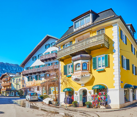 ST GILGEN, AUSTRIA - FEBRUARY 23, 2019: The stores and restaurants in the old town are located in historical edifices, lining the central streets and squares, on February 23 in St Gilgen