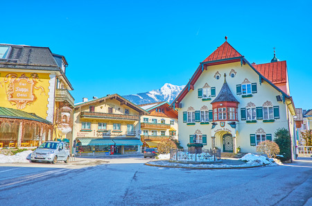 ST GILGEN, AUSTRIA - FEBRUARY 23, 2019: The Mozartplatz (square) of small Alpine village is lined with historical edifices of Rathaus (town hall), hotels, restaurants and stores, on February 23 in St Gilgen