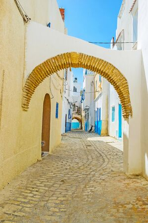 Enjoy the walk in medieval Arab Medina of Bizerte with preserved housing, arched passes, many backstreets and maze of narrow alleys, Tunisia