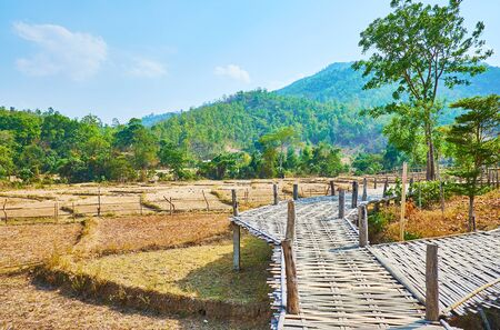The bamboo bridges are popular constructions in farmlands of Thailand, Boon Ko Ku So bamboo bridge is one of such landmarks, located in Pai suburb Zdjęcie Seryjne