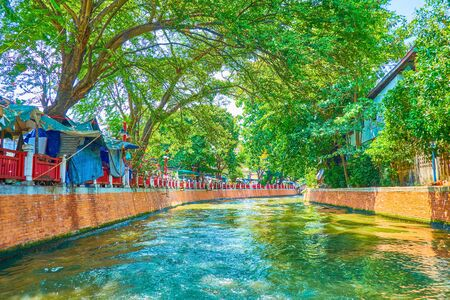 The Bang Lamphu Khlong is the central canal in old Bangkok, and leads through numerous markets with shabby stalls, mounted on the banks of it, Thailand 写真素材 - 130155173