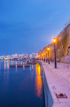 Walk the seaside promenade along the old port with many bright lanterns, reflected on water surface, Bizerte, Tunisia Zdjęcie Seryjne