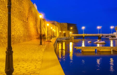 Bright illumination of Bizerte port and medieval rampart of Kasbah fortress, Tunisia