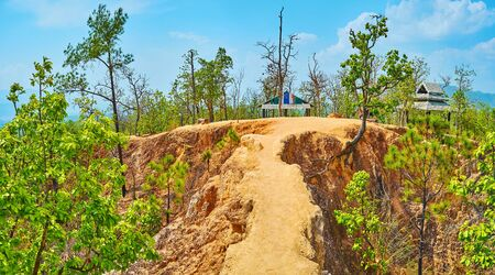 The red clay cliff of Pai Canyon, famous among the tourists, traveling in Northern Thailand
