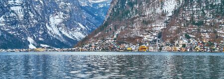 The small old town of Hallstatt is located at the foot of Salzberg Mount of Dachstein mountain range (Northern Limestone Alps) on the bank of Hallstatter see (lake), Salzkammergut, Austria