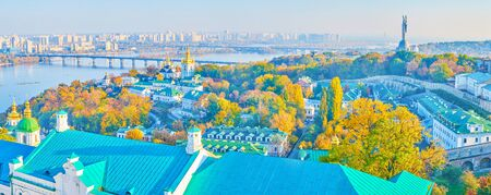 Panoramic view on the landmarks of the right bank of Kiev city with medieval religion Pechersk Lavra complex and the Motherland Monument of the background, Ukraine 写真素材 - 130156196