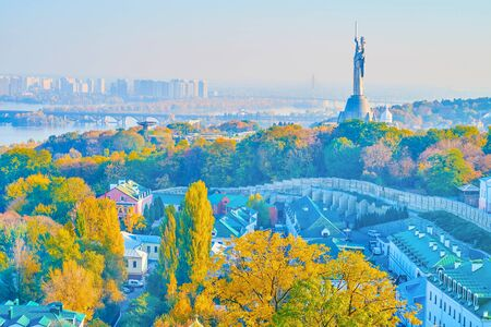 The large statue Motherland Monument is the symbol of the victory in WWII, located on the right bank in Kiev city, Ukraine 写真素材 - 130156197