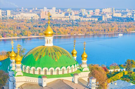 The beautiful green dome with golden stripes of the Refectory Church with amazing view on the Dnieper river and its left bank, Kiev, Ukraine 写真素材 - 130156200