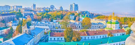 The beautiful panoramic view on medieval buildings of Kiev Pechersk Lavra and the modern edifices of the city on the background, Ukraine