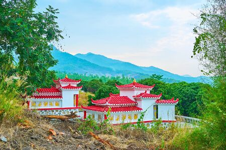 The scenic Chiese shrine on the hill among the greenery next to Yun Lai viewpoint, Santichon tea village, Thailand