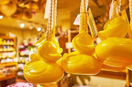 The yellow bath duck shaped soap in traditional eco-friendly workshop, using old recipes and only natural ingredients for skincare cosmetics production, Hallstatt, Salzkammergut, Austria
