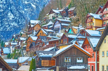 The slope of Salzberg mountain is occupied with old dense housing of Halltatt, Salzkammergut, Austria