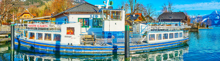 ST WOLFGANG, AUSTRIA - FEBRUARY 23, 2019: Panorama of he vintage Kaiserin Elisabeth ferry, moored in port on Wolfgangsee lake, on February 23 in St Wolfgang 報道画像