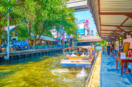 BANGKOK, THAILAND - APRIL 24, 2019: The Sapan Hua Chang Pier, the old boat stop in Saen Saep canal in business district, on April 24 in Bangkok