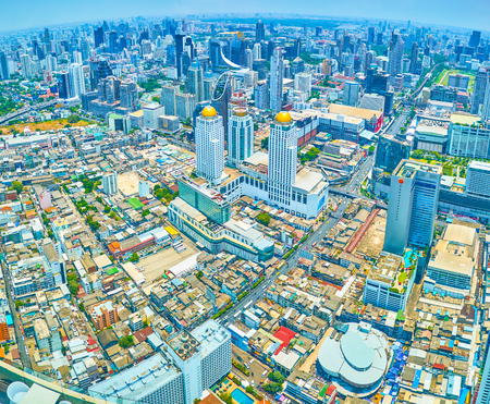 BANGKOK, THAILAND - APRIL 24, 2019: The aerial view from Baiyoke Tower II on business districts of the city with modern high edifices, on April 24 in Bangkok