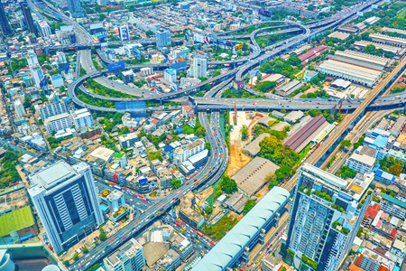 BANGKOK, THAILAND - APRIL 24, 2019: The large highway intersection with multi height roads in the heart of modern city connects various remote districts of the city, on April 24 in Bangkok Редакционное