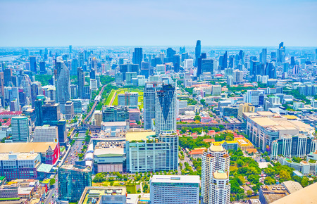 BANGKOK, THAILAND - APRIL 24, 2019: The business district of Bangkok boasts numerous modern high rises with unique design, large shopping areas and wide traffic roads, on April 24 in Bangkok