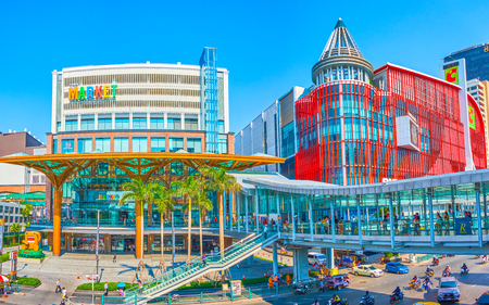 BANGKOK, THAILAND - APRIL 24, 2019: Panoramic view on large department stores with covered skywalk leading along all Ratchaprasong shopping area, on April 24 in Bangkok