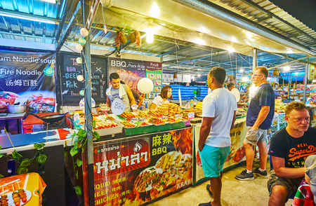 AO NANG, THAILAND - APRIL 25, 2019: The food court of Night Market, popular among the tourists, visiting resort, on April 25 in Ao Nang