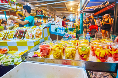 AO NANG, THAILAND - APRIL 25, 2019: Choose the tropical fruit salads or fresh cocktails in a stall of Night Market, on April 25 in Ao Nang