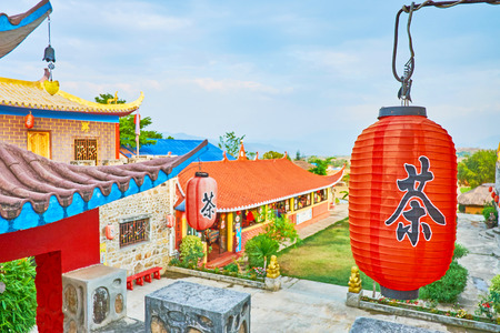 SANTICHON, THAILAND - MAY 5, 2019:  Chinese Yunnan cultural village boasts traditional Chinese architecture, many bright red lanterns, tea houses and tourist attractions, on May 5 in Santichon Редакционное