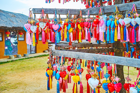 SANTICHON, THAILAND - MAY 5, 2019: The multitude of colorful hearts with tassels for wishes and names of visitors on the stand of Yun Lai viewpoint, on May 5 in Santichon
