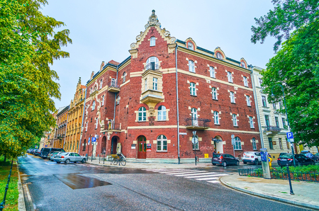 KRAKOW, POLAND - JUNE, 13, 2018: The old mansion, called Under The Singing Frog located in cozy historical neighborhood in surrounding of the greenery, on June 13 in Krakow