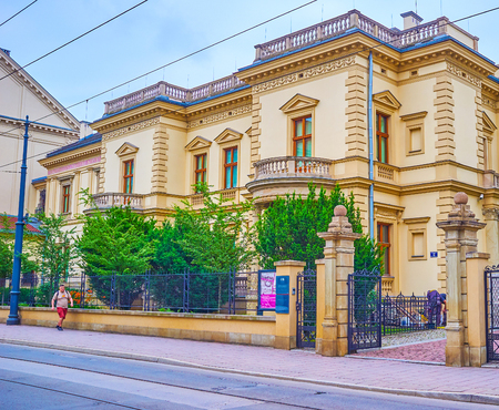 KRAKOW, POLAND - JUNE, 13, 2018: The historical palace with small garden in Pilsudski Street nowadays serves as the Czapski Museum, owning the collection of historical coins, on June 13 in Krakow Editorial