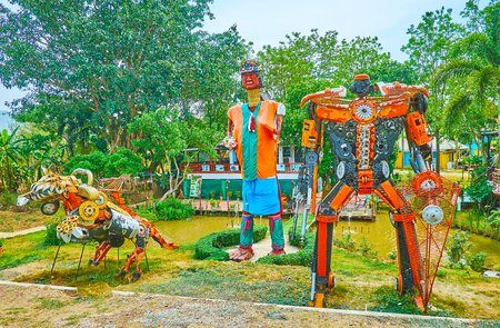 PAI, THAILAND - MAY 5, 2019: The scenic park with small ponds and interesing installations of transformer robots and Karen tribe long neck woman, on May 5 in Pai