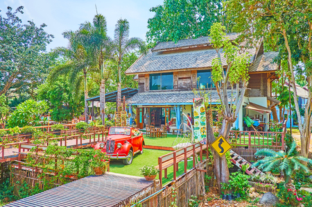 PAI, THAILAND - MAY 5, 2019: The countryside hotel-restaurant, surrounded by lush tropical carden and located in Pai suburb, next to Memorial bridge, on May 5 in Pai