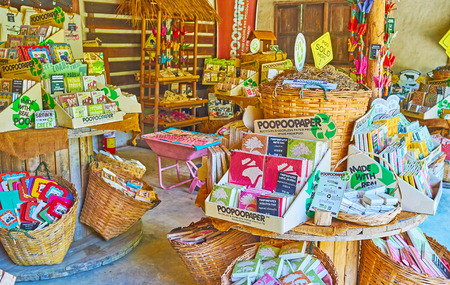 CHIANG MAI, THAILAND - MAY 5, 2019: Interior of souvenir shop in Poopoopaper park with interesting pieces of handmade paper - stickers, scratch pads, journals, postcards, note boxes, toys and decorations, on May 5 in Chiang Mai Редакционное