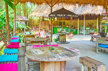 CHIANG MAI, THAILAND - MAY 5, 2019: The scenic lounge cafe of Poopoopaper park with bamboo canopy, wooden furniture and handmade decorations, on May 5 in Chiang Mai