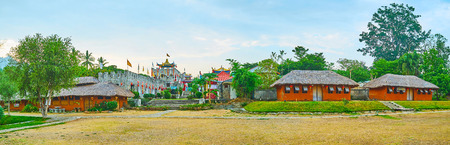 SANTICHON, THAILAND - MAY 5, 2019: Panorama of Chinese Cultural Center with stone fortress-like building and traditional adobe houses in front of the lawn, on May 5 in Santichon