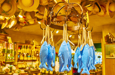 HALLSTATT, AUSTRIA - FEBRUARY 25, 2019: The blue fish shaped soap is hanging on the vintage round rack in old Salzkontor store, famous for high quality natural skincare and healthcare goods with mount