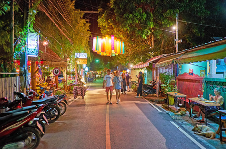 PAI, THAILAND - MAY 5, 2019: The Walking street becomes busy and interesting place every evening, here locate tourist cafes, bars, souvenir shops and stalls of Night Market, on May 5 in Pai
