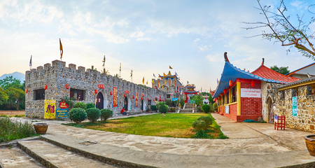 SANTICHON, THAILAND - MAY 5, 2019: The stone fortress, decorated with pavilions, flags, lanterns and Chinese inscriptions is the notable landmark, located in Chinese Cultural Center, on May 5 in Santichon