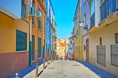Walk Calle Alta street, located on hilly area of old town, Malaga, Spain